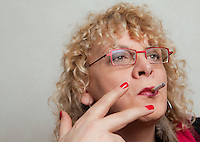 Michelle Blanc poses in her hotel room in Quebec city November 10, 2009. Born as a male, Michel was a suicidal mental health patient who discovered his gender identity disorder. With the help of the Internet to get support, she his now Michelle, a female successful Internet entrepreneur.