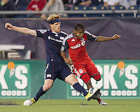 New England Revolution midfielder Pat Phelan (28) disrupts Toronto FC forward Joao Plata (7) dribble. In a Major League Soccer (MLS) match, the New England Revolution tied Toronto FC, 0-0, at Gillette Stadium on June 15, 2011.