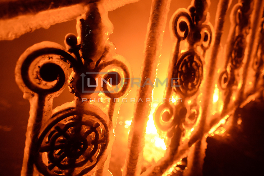 Contrast between the fire  of the molotovs and the ice on a railing when at night temperatures fell as low as -10C  during the   protest against new law to ban the right to  protest across the country.  Kiev. Ukraine