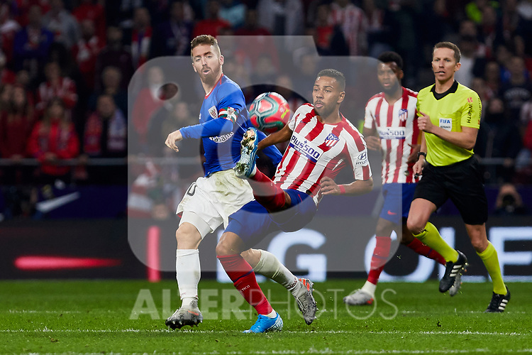 Renan Lodi of Atletico de Madrid and Iker Muniain of Athletic Club de Bilbao during the La Liga match between Atletico de Madrid and Athletic Club de Bilbao at Wanda Metropolitano Stadium in Madrid, Spain. October 26, 2019. (ALTERPHOTOS/A. Perez Meca)