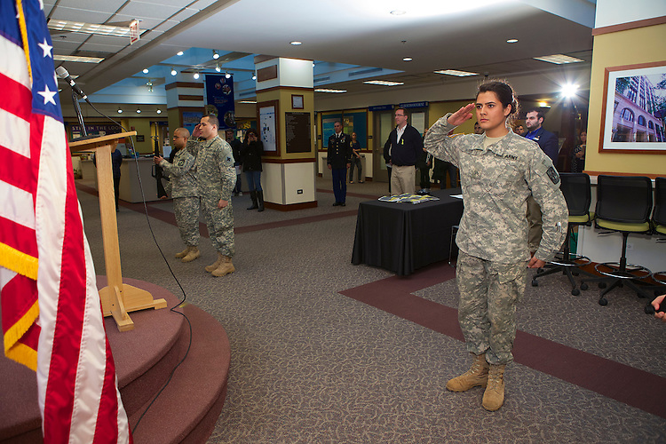 The DePaul Army ROTC presents the colors at the Veteran's Day Interfaith Service and Luncheon Tuesday, Nov. 11, 2014. The annual event is held in honor of past and present veterans. (DePaul University/Jeff Carrion)