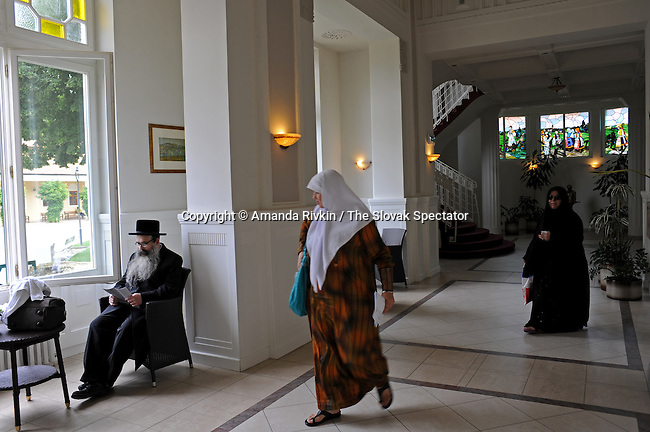 A Muslim tourist looks over at an Orthodox Jewish tourist inside Slovakia's first five-star hotel, the Hotel Thermia, on the thermal spa island in Piestany, Slovakia on June 25, 2010. Flags outside the Hotel Thermia include flags are from Israel, Saudi Arabia, Lebanon and others seldom seen side by side.