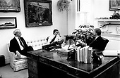 "United States President Jimmy Carter, right, chief speechwriter Jim Fallows, center, and US Secretary of Energy James R. Schlesinger, left, apply last-minute touches to the scheduled energy address to the nation on live television in the evening at the White House in Washington, DC on April 18, 1977.  In his remarks, the President will equate the energy crisis as the ""moral equivalent of war.""<br /> Credit: White House via CNP"