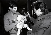 Montreal (QC) CANADA file photo - Dec 19 1987 - Jacques Chagnon (L) hold a baby to  Robert Bourassa visit Sun Youth