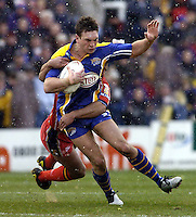 Pix: Ben Duffy/SWpix.com.....Rugby League Super League Leeds Rhinos v London Broncos .....22/02/2004..Leed's Kevin Sinfield is stopped by London's Dennis Moran..?COPYRIGHT PICTURE>>SIMON WILKINSON>>08700920092>>.