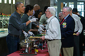 United States President Barack Obama and First Lady Michelle Obama serve Thanksgiving dinner to residents at the Armed Forces Retirement Home in Washington, DC, USA, 23 November 2016.<br /> Credit: Shawn Thew / Pool via CNP