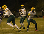 Manogue Miners quarterback Drew Scolari (12) looks to pass against Spanish Springs on Friday night, November 9, 2018 at Spanish Springs High School in Sparks, Nevada.