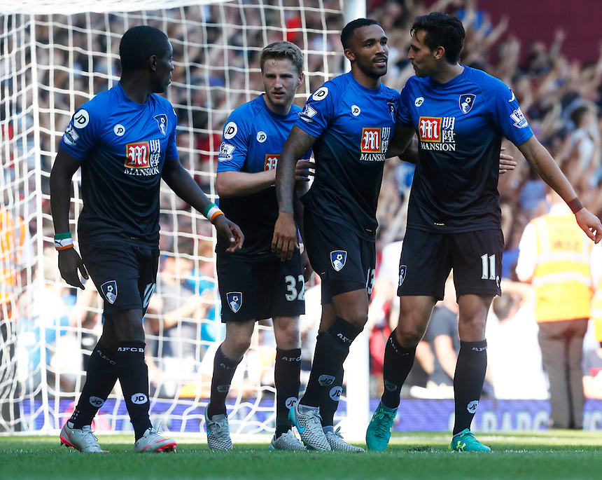 Bournemouth's Callum Wilson celebrates scoring his sides fourth goal  and his Hattrick<br /> <br /> Photographer Kieran Galvin/CameraSport<br /> <br /> Football - Barclays Premiership - West Ham United v Bournemouth - Saturday 22nd August 2015 - Boleyn Ground - London<br /> <br /> <br /> &copy; CameraSport - 43 Linden Ave. Countesthorpe. Leicester. England. LE8 5PG - Tel: +44 (0) 116 277 4147 - admin@camerasport.com - www.camerasport.com