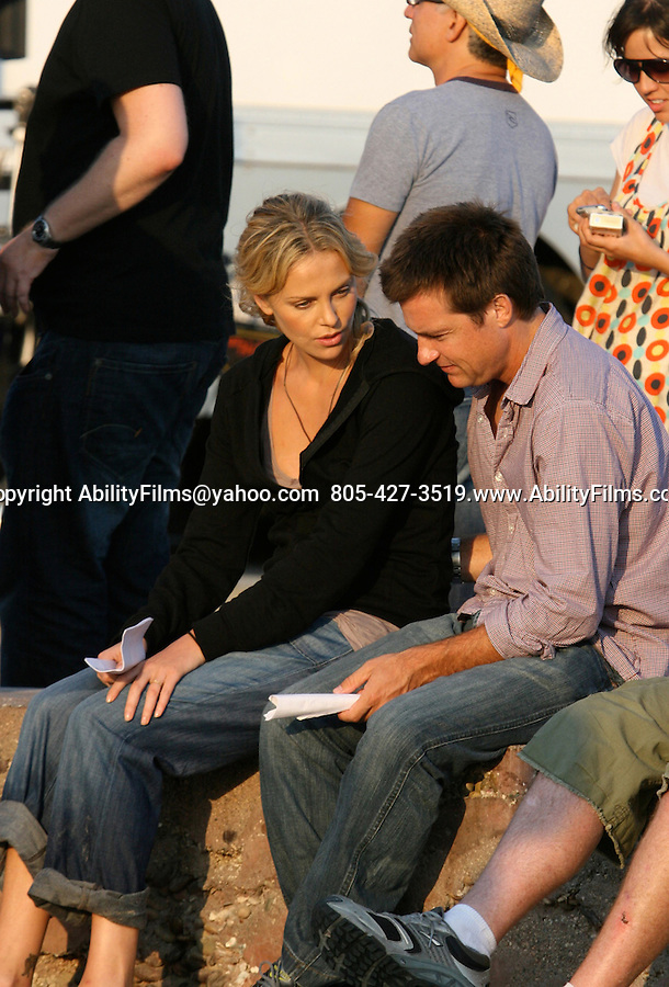 """AbilityFilms@yahoo.com  805-427-3519.www.AbilityFilms.com.Charlize Theron with Jason Bateman on the beach in Santa Monica playing with her dogs that's exclusive.. Then Filming a kissing scene for the movie """"Hancock"""" Non exclusive."""