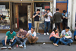 Brick Lane Tower Hamlets people eating Chinese food. London E1 UK