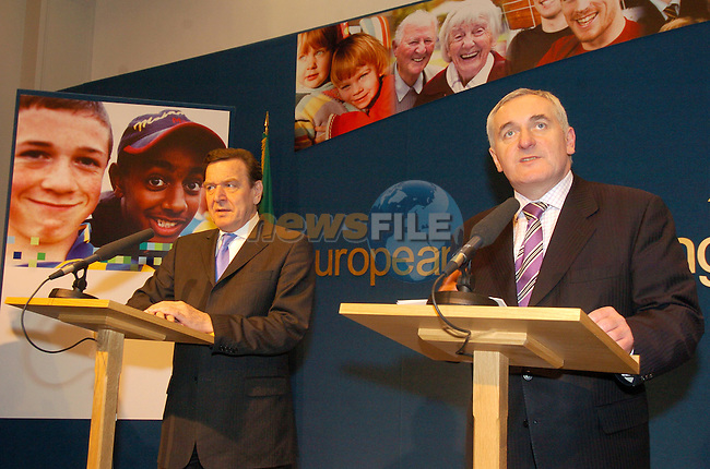 DUBLIN IRELAND, (L) German Chancellor, Mr. Gerhard Schroeder speaking a a press conference with Irish Prime Minister and President of the EU Bertie Ahern at Government Buildings, Dublin Ireland after there meeting non the new EU constitution. 9th February 2004.Photo AFP/NEWSFILE/FRAN CAFFREY..(Photo credit should read FRAN CAFFREY/NEWSFILE/AFP)...This Picture has been sent you under the condtions enclosed by:.Newsfile Ltd..the Studio,.Millmount Abbey,.Drogheda,.Co Meath..Ireland..Tel: +353(0)41-9871240.Fax: +353(0)41-9871260.GSM: +353(0)86-2500958.email: pictures@newsfile.ie.www.newsfile.ie.FTP: 193.120.102.198..This picture is from Fran Caffrey@newsfile.ie