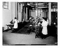 Laundry room of the Chateau Frontenac with women at work at a mangle, sewing machine and wooden wash tub, photograph, from the Archives of the Chateau Frontenac, Quebec City, Quebec, Canada. The Chateau Frontenac opened in 1893 and was designed by Bruce Price as a chateau style hotel for the Canadian Pacific Railway company or CPR. It was extended in 1924 by William Sutherland Maxwell. The building is now a hotel, the Fairmont Le Chateau Frontenac, and is listed as a National Historic Site of Canada. The Historic District of Old Quebec is listed as a UNESCO World Heritage Site. Copyright Archives Chateau Frontenac / Manuel Cohen