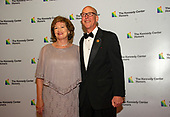 United States Representative Greg Walden (Republican of Oregon) and his wife, Mylene, arrive for the formal Artist's Dinner honoring the recipients of the 42nd Annual Kennedy Center Honors at the United States Department of State in Washington, D.C. on Saturday, December 7, 2019. The 2019 honorees are: Earth, Wind & Fire, Sally Field, Linda Ronstadt, Sesame Street, and Michael Tilson Thomas.<br /> Credit: Ron Sachs / Pool via CNP
