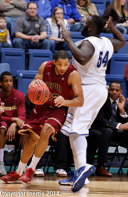SIOUX FALLS, SD - MARCH 8:  Marcellus Barksdale #22  of IUPUI drives into Steve Forbes #54 of IPFW during their quarterfinal game at the 2014 Summit League Basketball Championships at the Sioux Falls Arena. (Photo by Dick Carlson/Inertia)