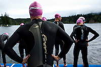 14 AUG 2010 - KITZBUEHEL, AUT - Competitors wait for the start of their wave at the Jedermann Triathlon (PHOTO (C) NIGEL FARROW)