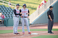 Arkansas Travelers manager Mitch Canham (12) talks to infielder Evan White (10) during a Texas League game between the Northwest Arkansas Naturals and the Arkansas Travelers on May 30, 2019 at Arvest Ballpark in Springdale, Arkansas. (Jason Ivester/Four Seam Images)