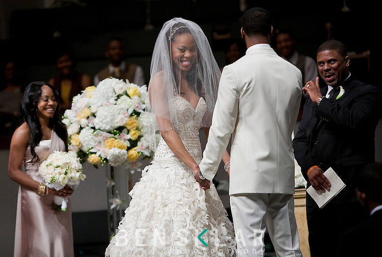 Richards smiles on the alter at the Hyde Park Baptist Church. Sanya Richards, Olympic gold medalist, and Aaron Ross, New York Giants cornerback, wed in Austin, Texas on Friday, February 26, 2010...