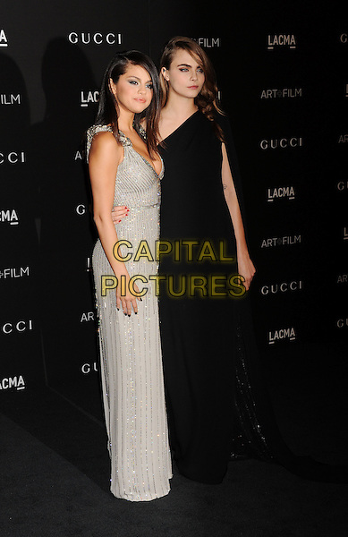 LOS ANGELES, CA - NOVEMBER 01: Actress/singer Selena Gomez (L) and actress Cara Delevingne attend the 2014 LACMA Art + Film Gala honoring Barbara Kruger and Quentin Tarantino presented by Gucci at LACMA on November 1, 2014 in Los Angeles, California.<br /> CAP/ROT/TM<br /> &copy;Tony Michaels/Roth Stock/Capital Pictures