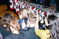 People take pictures with their cell phones as former president Bill Clinton speaks before former Secretary of State and Democratic presidential candidate Hillary Rodham Clinton speaks at a rally at Nashua Community College in Nashua, New Hampshire, on Tues. Feb. 2, 2016. Former president Bill Clinton also spoke at the event. The day before, Hillary Clinton won the Iowa caucus by a small margin over Bernie Sanders.