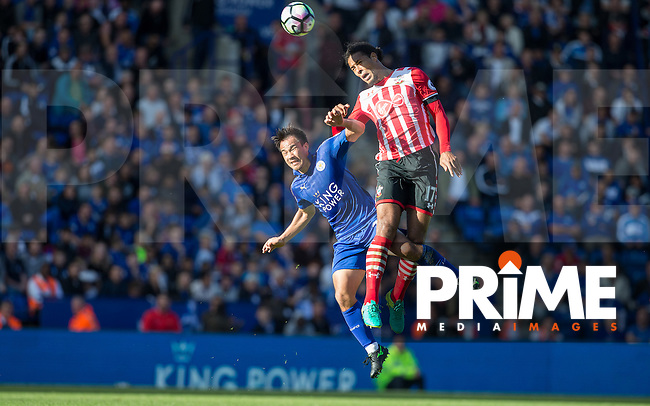 Virgil van Dijk of Southampton beats Shinji Okazaki of Leicester City  in the air during the Premier League match between Leicester City and Southampton at the King Power Stadium, Leicester, England on 2 October 2016. Photo by Andy Rowland.