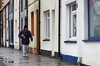 Pictured: A man walks on the High Street in Rhymney. Thursday 12 December 2019<br /> Re: Realistic looking baby dolls used for therapy at the Oaklands Day Centre in Rhymney near Tredegar south Wales, UK.