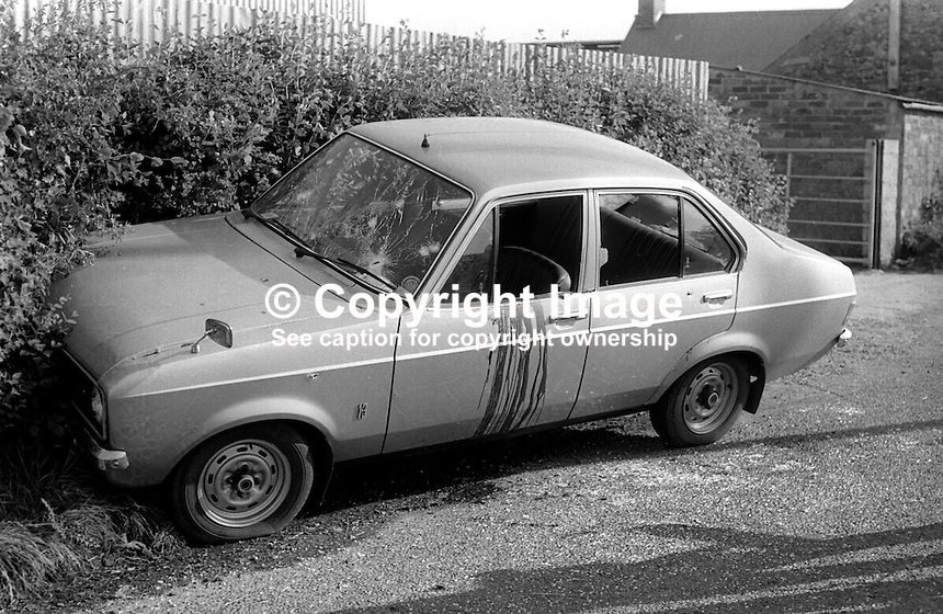 The unmarked police car in which three police officers died whilst on routine patrol near Ardboe, Co Tyrone, on 2nd June 1977. The ambush was carried out by three members of the Provisional IRA each armed with an Armalite rifle. After the police vehicle crashed the gunmen approached firing a further 20 shots into the Ford Escord. Ardboe is on the western shore of Lough Neagh. In 1979 a 22 year old Coalisland man was jailed for life for the three murders. The policemen who died were: Samuel Derek Davison, Kenneth Norman Lynch and Hugh Martin. 197706020206b<br /> <br /> Copyright Image from Victor Patterson, 54 Dorchester Park, Belfast, UK, BT9 6RJ<br /> <br /> Tel: +44 28 9066 1296<br /> Mob: +44 7802 353836<br /> Voicemail +44 20 8816 7153<br /> Email: victorpatterson@me.com<br /> Email: victorpatterson@gmail.com<br /> <br /> IMPORTANT: My Terms and Conditions of Business are at www.victorpatterson.com