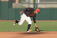 AZL Giants Orange second baseman Jose Rivero (2) fields a ground ball during an Arizona League game against the AZL Rangers at Scottsdale Stadium on August 4, 2018 in Scottsdale, Arizona. The AZL Giants Black defeated the AZL Rangers by a score of 3-2 in the first game of a doubleheader. (Zachary Lucy/Four Seam Images)