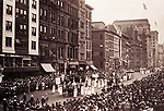View of a suffrage parade on a city street flanked by a large crowd, ca. 1913-1917. Photographer: Jessie Tarbox Beals