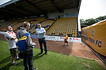 Mansfield Town Football Club Open Day, 14/07/2013. Field Mill stadium, League Two. The club historian giving visitors a guided tour of Mansfield Town's Field Mill stadium during an open day held for the club's supporters. Mansfield Town achieved promotion back to England's Football League by winning the Conference National in season 2012-13. Field Mill was the oldest ground in the Football League, hosting football since 1861 although some reports date it back as far as 1850, with Mansfield Town having played there since 1919. Photo by Colin McPherson.