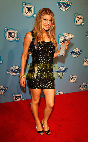 FERGIE - STACY FERGUSON.At the 18th Annual MuchMusic Video Awards, Chum/City Building, Toronto, Ontario, Canada,17 June 2007..full length Much Music stacey black gold and silver beaded mini dress trophy winner.CAP/ADM/BP.©Brent Perniac/AdMedia/Capital Pictures.