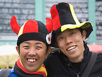 Germany, DEU, Dortmund, 2006-Jun-22: FIFA football world cup (USA: soccer world cup) 2006 in Germany; two Japanese football fans in good mood posing with hats in German national colours.