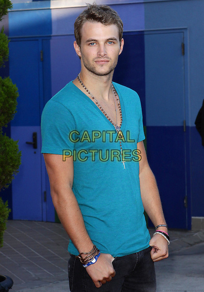 "JAMES PRESTON.""Do Something 101 Back Pack Party""  held at The Globe Theatre at Universal, Universal City, California, USA..August 8th, 2010.half length blue green teal t-shirt v-neck necklaces stubble facial hair bracelets .CAP/ADM/TC.©T. Conrad/AdMedia/Capital Pictures."