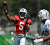 New York Jets quarterback Teddy Bridgewater #5 throws a pass to Trenton Cannon #40 during team practice at the Atlantic Health Jets Training Center in Florham Park, NJ on Sunday, July 29, 2018.