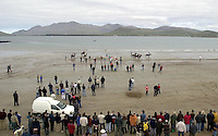BALLYFERRITER RACES-DINGLE 5-5-02<br /> Horse racing has taken place on Ballyferriter Strand in County Kerry only once in the last 50 years and that was in 1972, but thousands turned out to the picturesque beach outside Dingle in County Kerry to witness the revival on Sunday. <br /> Our picture shows the horses setting off in the 1 mile race.<br /> Picture by Don MacMonagle