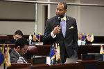 Nevada Senate Minority Leader Aaron Ford, D-Las Vegas, speaks on the Senate floor at the Legislative Building in Carson City, Nev., on Friday, April 3, 2015. <br /> Photo by Cathleen Allison