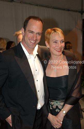 "Christopher Meloni, star of the NBC series ""Law and Order: Special Victims Unit"" and his wife, Doris, arrive for the party hosted by Bloomberg News following the 2003 White House Correspondents Dinner in Washington, DC on April 26, 2003..Credit: Ron Sachs / CNP"