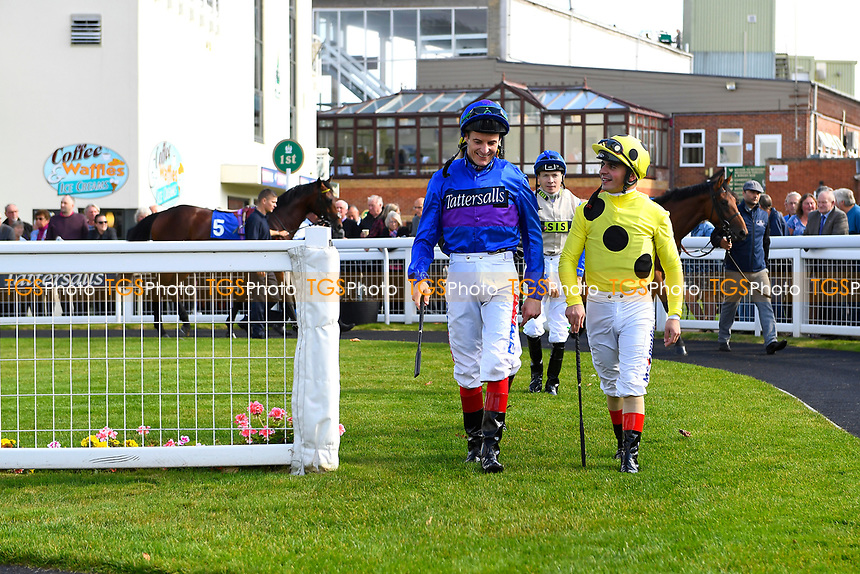 Jockeys Andrea Atzeni (r) and Fran Berry share a joke in the Parade Ring during Afternoon Racing at Salisbury Racecourse on 3rd October 2018