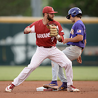 NWA Democrat-Gazette/ANDY SHUPE<br /> Arkansas second baseman Jack Kenley looks at first Friday, May 10, 2019, after forcing out LSU shortstop Josh Smith on a fielder's choice during the first inning at Baum-Walker Stadium in Fayetteville. Visit nwadg.com/photos to see more photographs from the game.