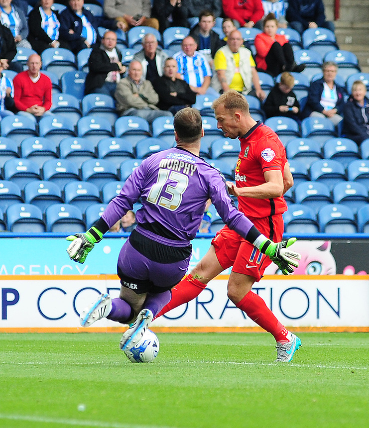 Blackburn Rovers' Jordan Rhodes is denied by Huddersfield Town's Joe Murphy<br /> <br /> Photographer Chris Vaughan/CameraSport<br /> <br /> Football - The Football League Sky Bet Championship - Huddersfield Town v Blackburn Rovers - Saturday 15th August 2015 - The John Smith's Stadium - Huddersfield<br /> <br /> &copy; CameraSport - 43 Linden Ave. Countesthorpe. Leicester. England. LE8 5PG - Tel: +44 (0) 116 277 4147 - admin@camerasport.com - www.camerasport.com