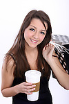 A young woman with a coffee mug and shopping bags