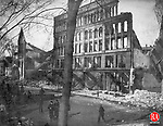 Debris lined what was left of the sidewalk after the February 2-3 1902 fire that swept through Waterbury causing $2 million in damage. Buildings were burned on Bank, Grand, and South Main Streets.