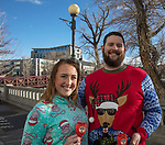 Cate Kegg and David Buell during the Ugly Sweater Wine Walk in downtown  Reno on Saturday, Dec. 16, 2017.