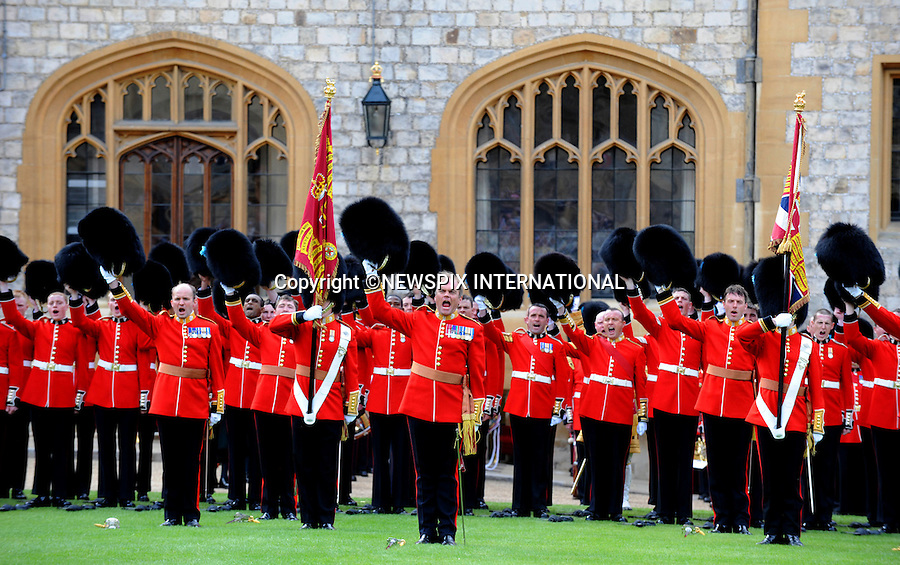"""QUEEN.inspects the Irish Guards on the Quadrangle at Windsor Castle..The Queen, Colonel-in-Chief, accompanied by The Duke of Edinburgh, presented new Colours to the 1st Battalion Irish Guards at Windsor Castle..Photo Credit: ©I Houlding_Newspix International..**ALL FEES PAYABLE TO: """"NEWSPIX INTERNATIONAL""""**..PHOTO CREDIT MANDATORY!!: NEWSPIX INTERNATIONAL..IMMEDIATE CONFIRMATION OF USAGE REQUIRED:.Newspix International, 31 Chinnery Hill, Bishop's Stortford, ENGLAND CM23 3PS.Tel:+441279 324672  ; Fax: +441279656877.Mobile:  0777568 1153.e-mail: info@newspixinternational.co.uk"""