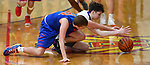 Roxana forward Jake Golenor (left) and Alton Marquette guard Spencer Cox get tangled up as they grab for a loose ball. Alton Marquette played Roxana in the Class 2A Roxana boys basketball regional final at Roxana High School in Roxana, Illinois on Friday February 28, 2020. <br /> Tim Vizer/Special to STLhighschoolsports.com