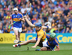 Shane O Donnell of Clare in action against James Barry of Tipperary during their quarter final at Pairc Ui Chaoimh. Photograph by John Kelly.