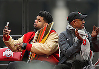 Running back Ezekiel Elliott takes a selfie with the national championship trophy while OSU president Michael V. Drake looks the other direction during the Ohio State football National Championship celebration at Ohio Stadium on Saturday, January 24, 2015. (Columbus Dispatch photo by Jonathan Quilter)