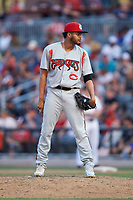 Carolina Mudcats relief pitcher Rodrigo Benoit (13) looks to his catcher for the sign against the Fayetteville Woodpeckers at SEGRA Stadium on May 18, 2019 in Fayetteville, North Carolina. The Mudcats defeated the Woodpeckers 6-4. (Brian Westerholt/Four Seam Images)
