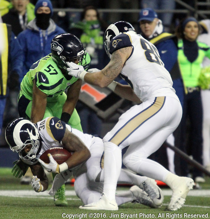 Los Angeles Rams tight end Tyler Higbee (89) grabs the face mask of Seattle Seahawks outside linebacker Mike Morgan (57) after Morgan tackled running back Todd Gurley (30) at CenturyLink Field in Seattle, Washington on December 15, 2016.  The Seahawks beat the Rams 24-3.  ©2016. Jim Bryant Photo. All Rights Reserved