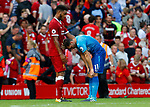 Liverpool's Joe Gomez (L) consoles Arsenal's Mesut Ozil after the premier league match at Anfield Stadium, Liverpool. Picture date 27th August 2017. Picture credit should read: Paul Thomas/Sportimage