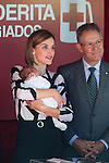 Queen Letizia of Spain holds a baby during the Red Cross Fundraising day event (Dia de la Banderita) in Madrid, Spain. October 02, 2015. (ALTERPHOTOS/Victor Blanco)